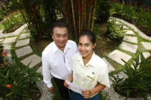 Lucille Annabelle Latiff scored seven A1s and an A2 to become one of the top Malay students. Her father Lenny Allen Latiff was so overjoyed, he put his work aside to meet her. -- ST PHOTO: KEVIN LIM