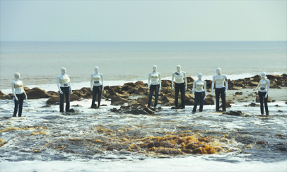 Several models, wearing trousers made by global fashion leaders alleged to have been using harmful substances in their clothing process, are set up outside a sewage drain exit at the estuary of Hangzhou Bay on December 4. Photo: Courtesy of Greenpeace