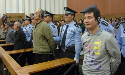 Suspects listen to their verdicts at a court in Kunming, Yunnan province, November 6, 2012. Photo source (Reuters)