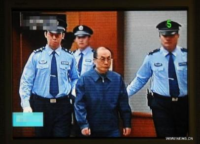Video grab shows China's former railways minister Liu Zhijun being brought into the Beijing Second Intermediate People's Court in Beijing, capital of China, June 9, 2013. Liu stood trial in the court on Sunday on charges of bribery and abuse of power. Source - Xinhua, by Gong Lei)