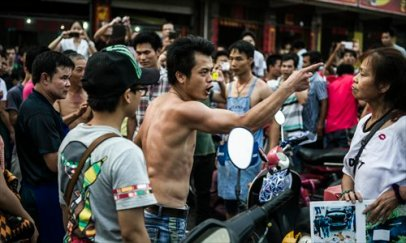 "A restaurant owner gestures at animal rights activist Du Yufeng during a verbal fight in Yulin, South China's Guangxi Zhuang Autonomous Region on June 21, locally known as ""Dog Meat Festival."" Photo: Li Hao for the Global Times"
