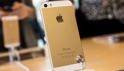 The gold version of the iPhone 5S is displayed at an Apple store on September 20, 2013 in New York City. Photograph by Andrew Burton/Getty Images